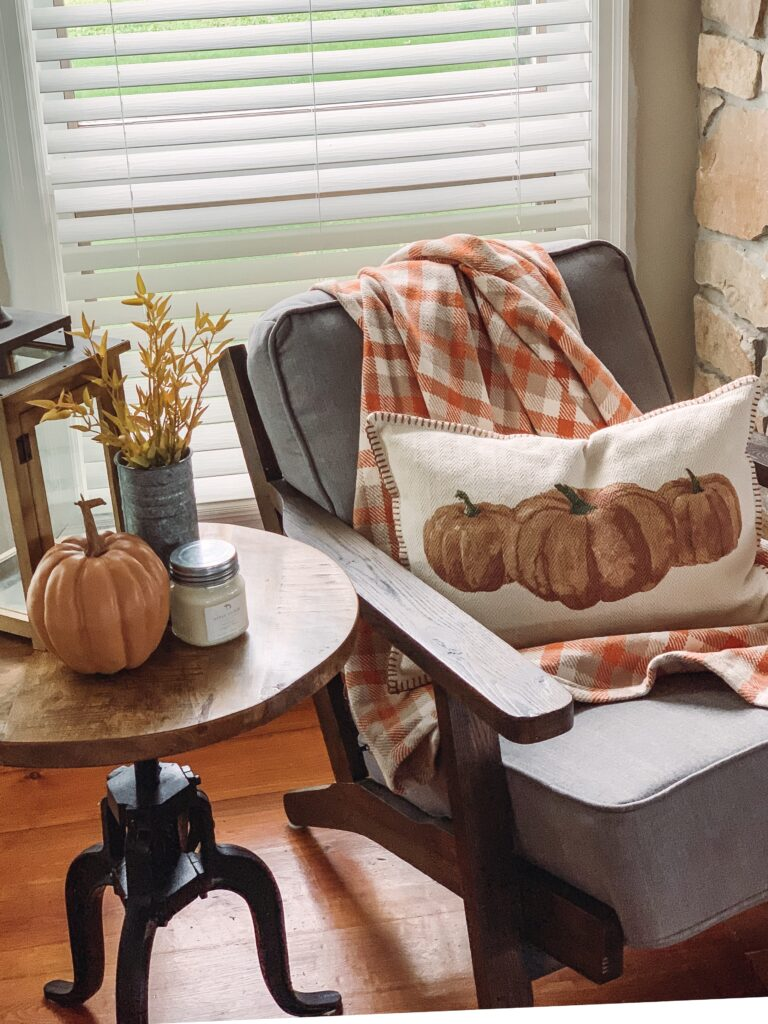 pumpkin pillow in cozy fall decor