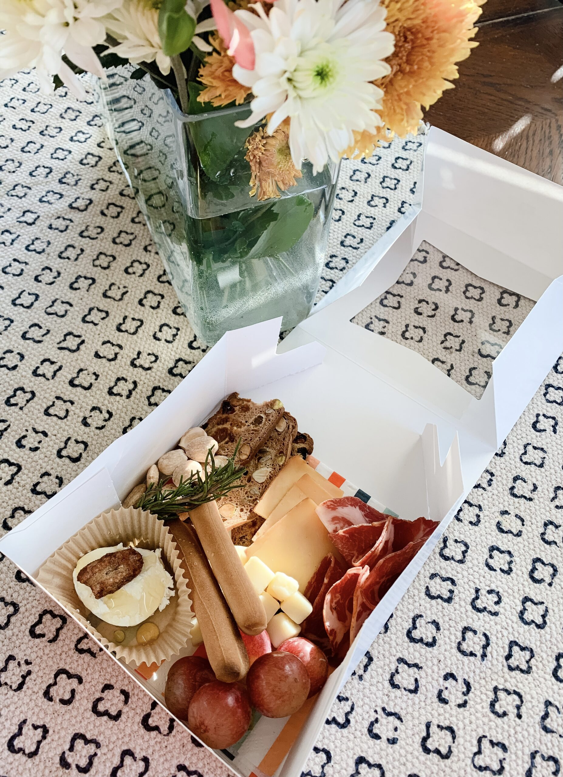 individual COVID friendly charcuterie box with assorted meat and cheeses