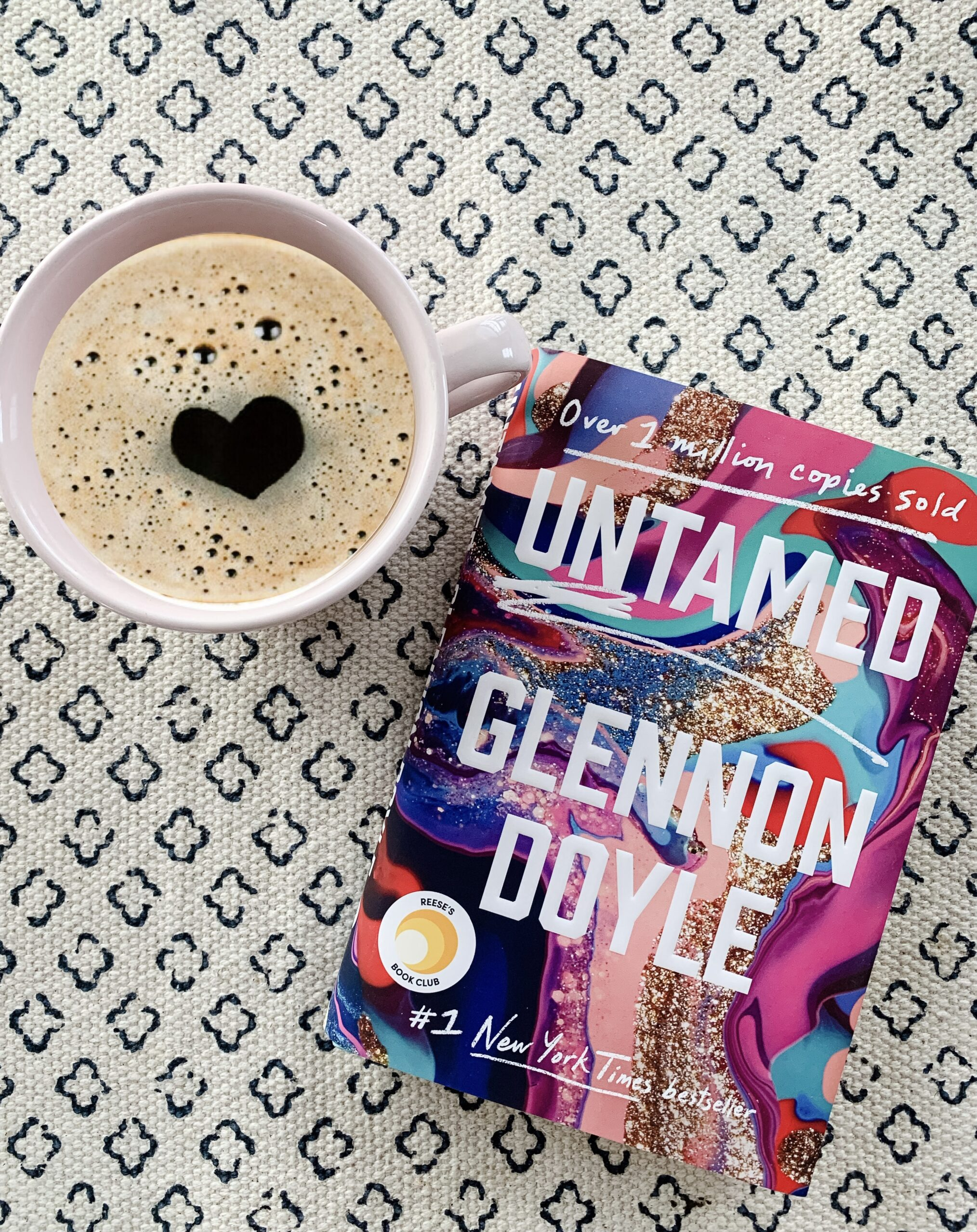 Untamed novel by Glennon Doyle with a cup of coffee, This is part of the Book-A-Month Reading Challenge