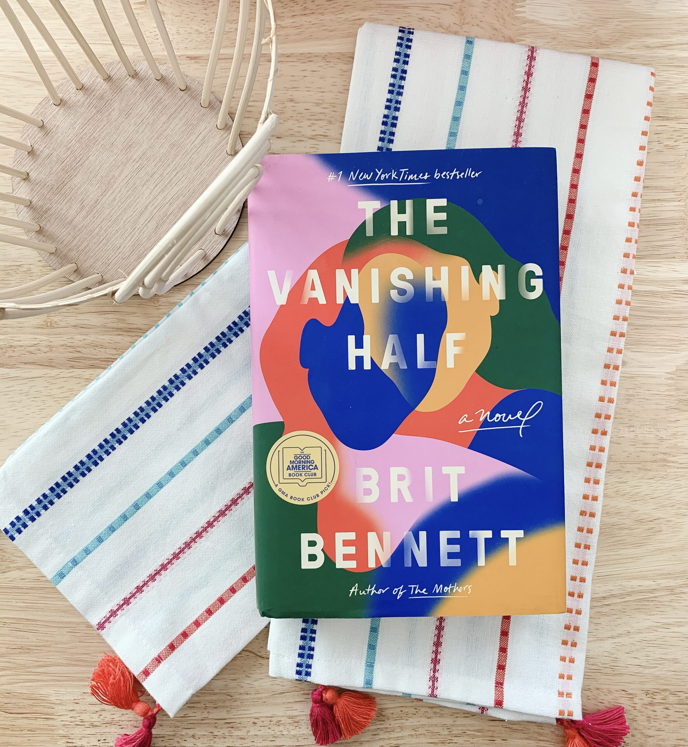image of bright colored towels and cover of the novel The Vanishing Half by Brit Bennett